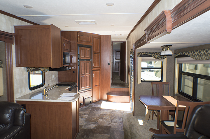"33', 3 Slides, 33"" TV, Fireplace,    Electric Awning w/LED Lights,    Queen Bed, Rear Entertainment Center,    Lots of Storage. MSRP $54,141      Special Price $38,900"