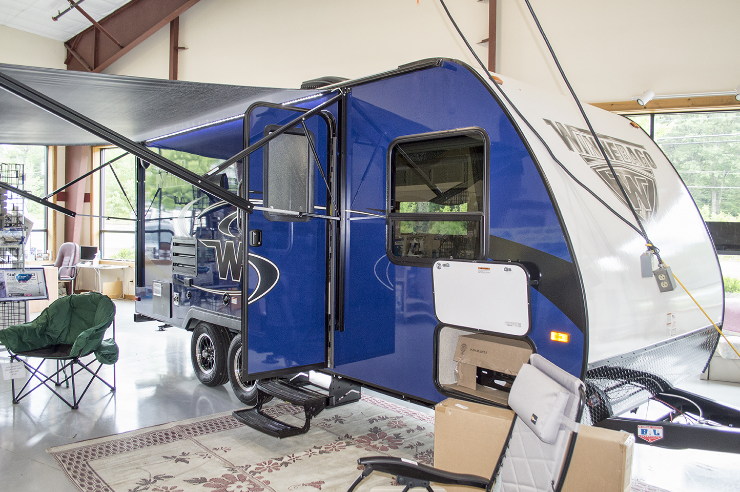 Lightweight, aerodynamic  Just 3800 lbs GVWR  Slideout, Awning, Great Kitchen  Full Wet Bath, And it's Blue!    MSRP $24,021  Special Price $18,900