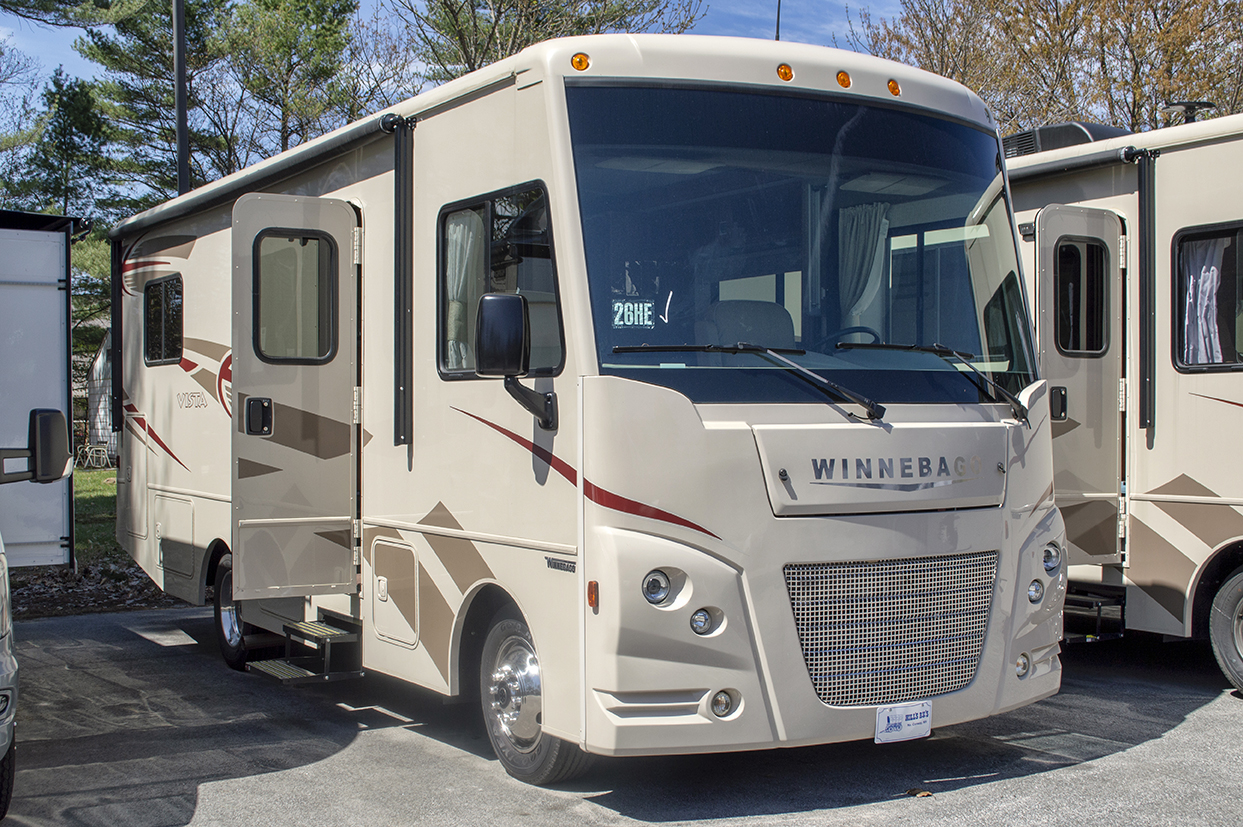 """Save over $17,000. Under 30 feet, with   walkaround queen bed, slideout, leveling   jacks, rearview monitor system, power   awning, generator, air conditioner, 32"""" HDTV.   MSRP $101,170    Special Price $83,900"""