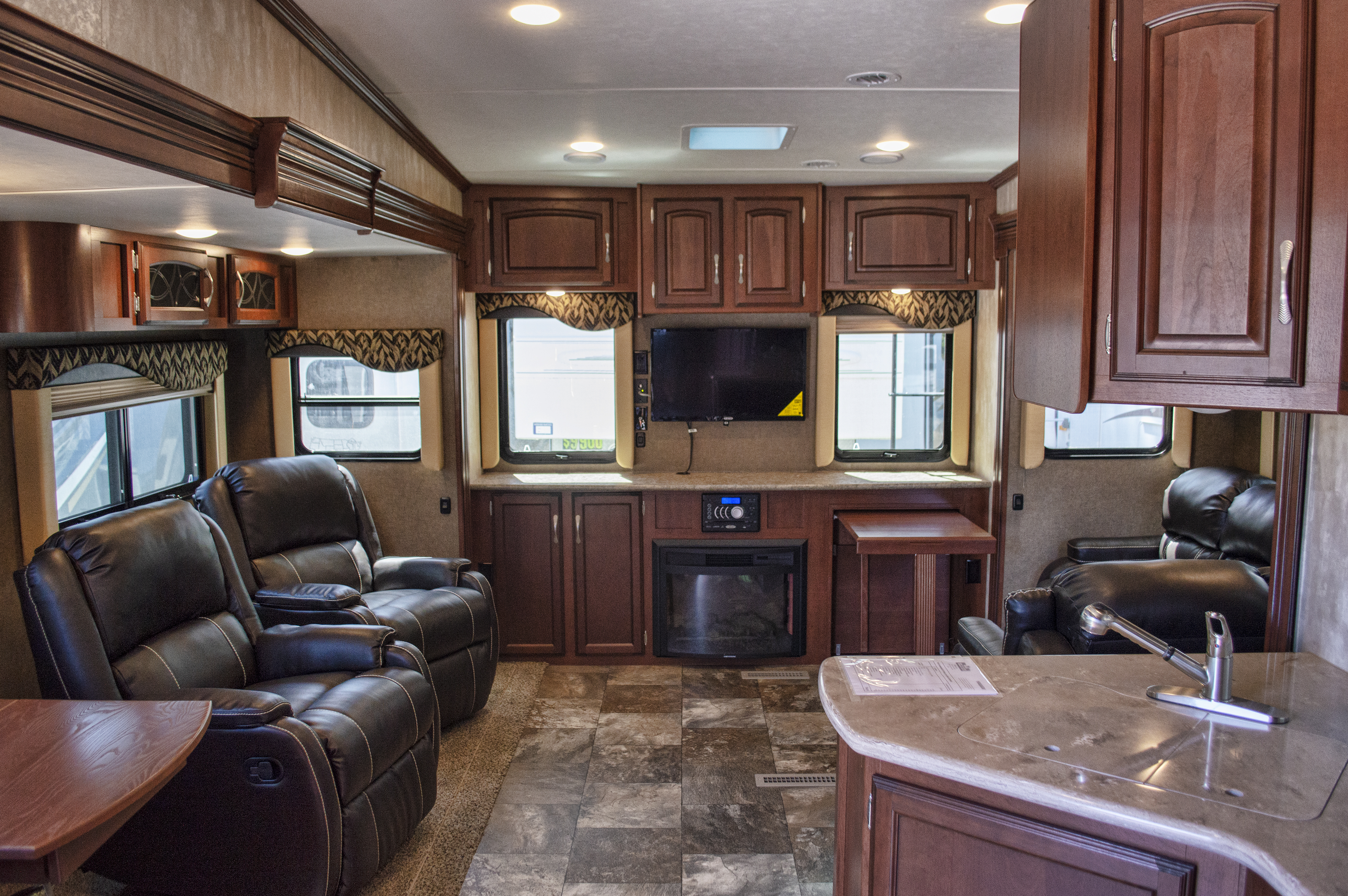 """33', 3 Slides, 33"""" TV, Fireplace,    Electric Awning w/LED Lights,    Queen Bed, Rear Entertainment Center,    Lots of Storage. MSRP $54,141      Special Price $38,900"""